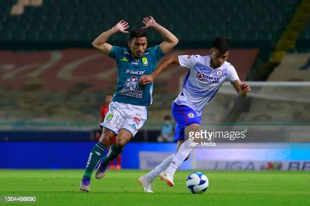 Angel Mena of Leon fights for the ball with Matias Fernandez of Cruz Azul during the 8th round match between Leon and Cruz Azul as part of the Torneo...