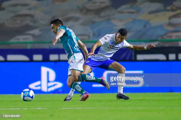 Angel Mena of Leon fights for the ball with Orbelin Pineda of Cruz Azul during the 8th round match between Leon and Cruz Azul as part of the Torneo...