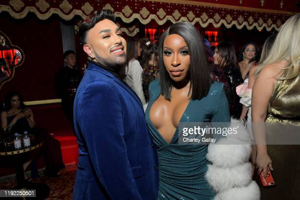 Angel Merino and Jackie Aina attend Lancôme x Vogue L'Absolu Ruby Holiday Event at Raspoutine on December 05 2019 in West Hollywood California