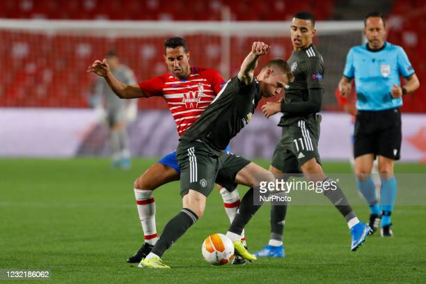 Angel Montoro, of Granada CF and Scott Mctominay of Manchester United during the UEFA Europa League Quarter Final leg one match between Granada CF...