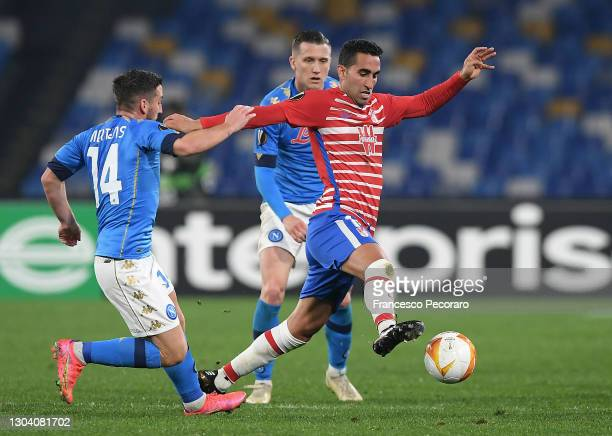 Angel Montoro Sanchez of Granada CF is challenged by Dries Mertens of SSC Napoli during the UEFA Europa League Round of 32 match between SSC Napoli...