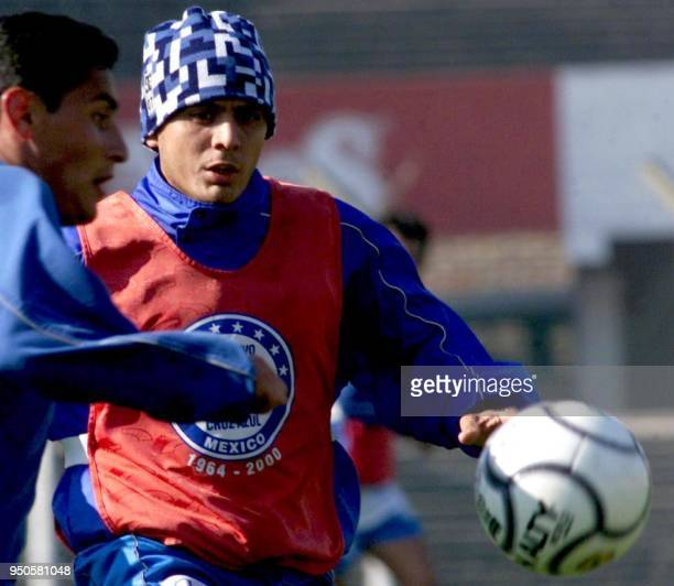 Angel Morales player of Mexico's Cruz Azul fights for the ball with a reserve player during a training session at the Independiente Club in Buenos...
