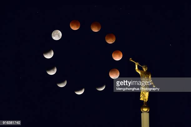 angel moroni and moon eclipse - total lunar eclipse stock photos and pictures