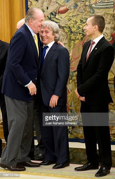 Angel Nieto and Jorge Lorenzo are received by King Juan Carlos I of Spain at Zarzuela Palace on March 2 2011 in Madrid Spain