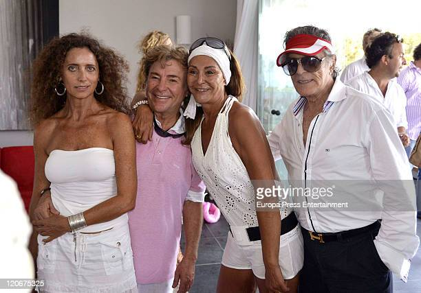 Angel Nieto his wife Mari Angeles Grajal and Jaime Ostos attend the Norma Duval Party in Tagomago private island of her boyfriend Mathias Kuehn on...