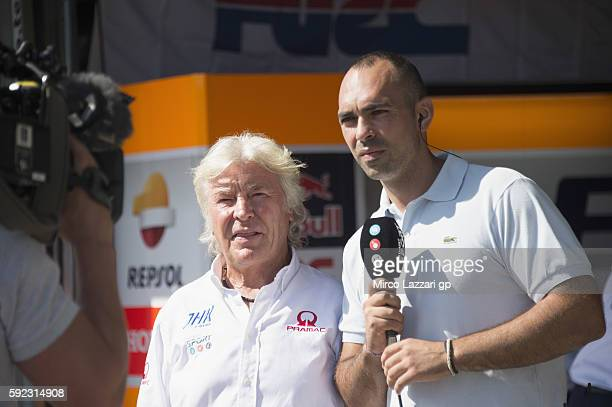 Angel Nieto of Spain speaks with journalists at the end of the qualifying practice during the MotoGp of Czech Republic Qualifying at Brno Circuit on...