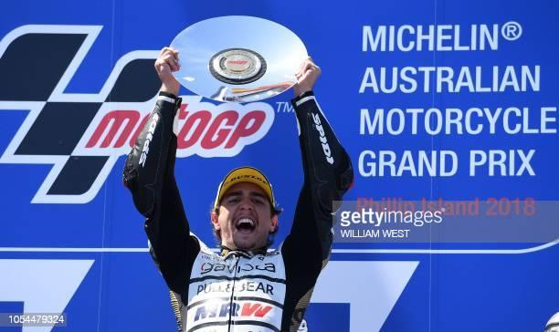 KTM Angel Nieto Team Moto3 Spanish rider Albert Arenas celebrates his victory on podium of the Australian Grand Prix Moto3 race at Phillip Island on...