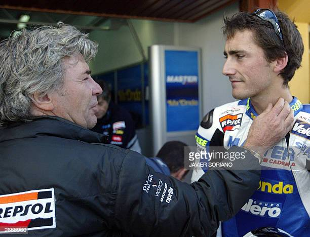 Angel Nieto thirteentime World Champion Congratulates his son Pablo Nieto after he obtained second place in the pole during the second 125cc...