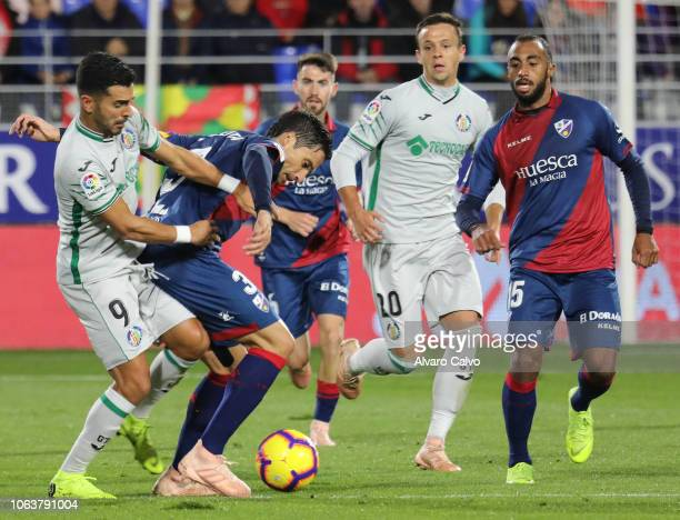 Angel of Getafe and Exteita of Huesca during the La Liga match between SD Huesca and Getafe at El Alcoraz on November 5 2018 in Huesca Spain
