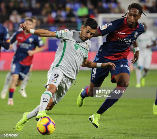 Angel of Getafe and Semedo of Huesca during the La Liga match between SD Huesca and Getafe at El Alcoraz on November 5 2018 in Huesca Spain