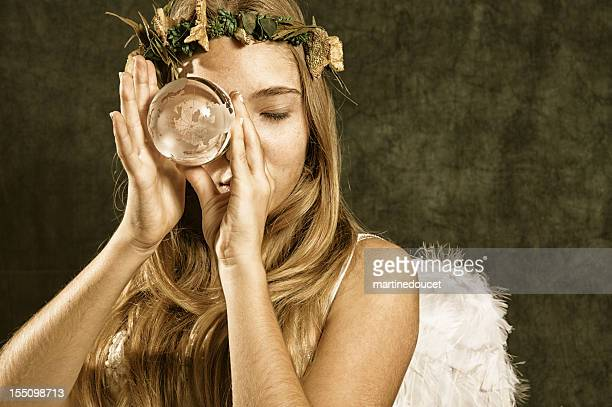 angel of nature holding earth - earth angel stock pictures, royalty-free photos & images