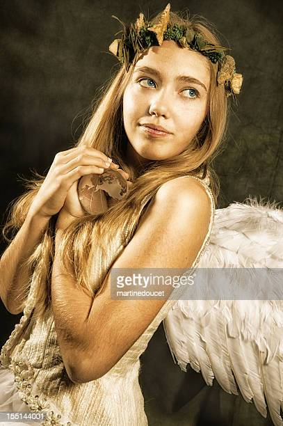 Angel of Nature holding earth.