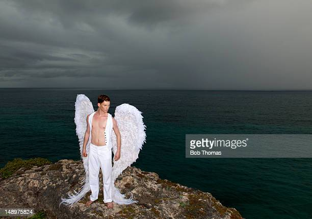 Angel on a cliff edge, with storm approaching