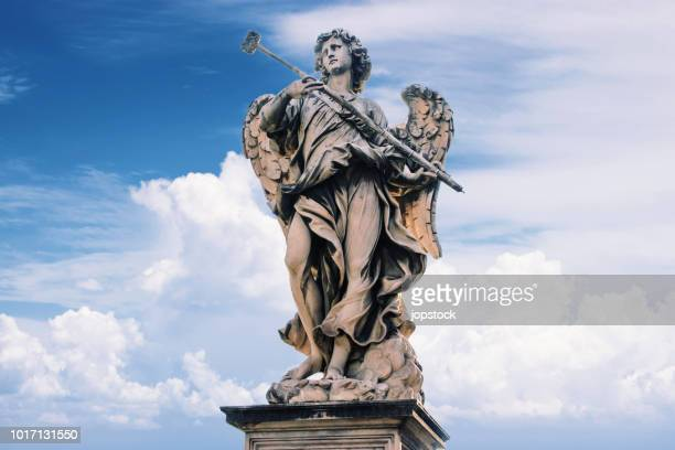 angel on the sant'angelo bridge, rome. - religious saint stock pictures, royalty-free photos & images
