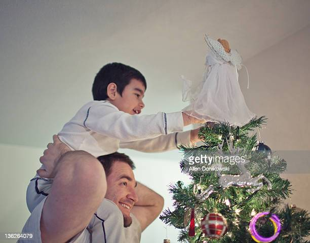 angel on tree - carrying a person on shoulders stock photos and pictures