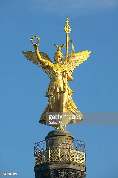Angel on Victory Column (Siegessaeule) in Berlin Tiergarten Park in Germany.