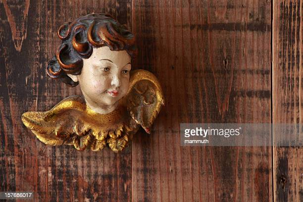 angel on wooden background