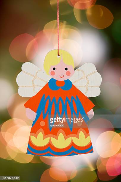 Angel Ornament Hanging in Front of Christmas Tree Lights, Copyspace