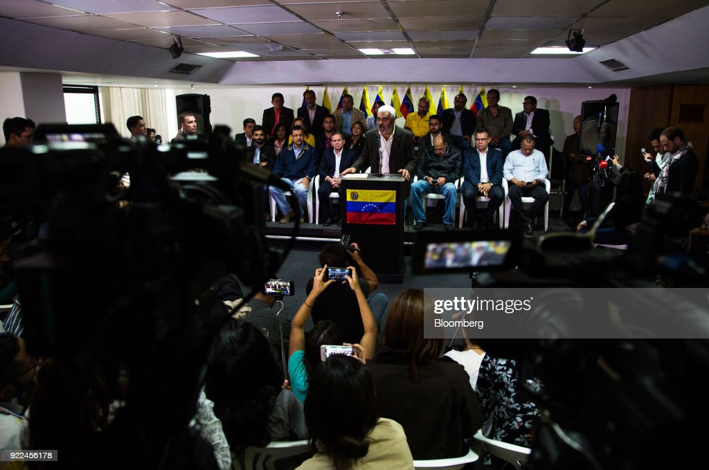 Angel Oropeza, political coordinator of the the Democratic Unity Roundtable (MUD), center, speaks during a press conference in Caracas, Venezuela, on Wednesday, Feb. 21, 2018. Venezuela's opposition coalition announced it will boycott this year's presidential ballot, saying that in its current form the vote will be neither free nor fair. Photographer: Wil Riera/Bloomberg via Getty Images