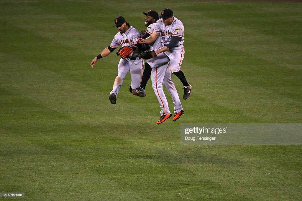 Angel Pagan #16, Denard Span #2 and Hunter Pence #8 of the San Francisco Giants celebrate their 7-2 victory over the Colorado Rockies at Coors Field on April 12, 2016 in Denver, Colorado.