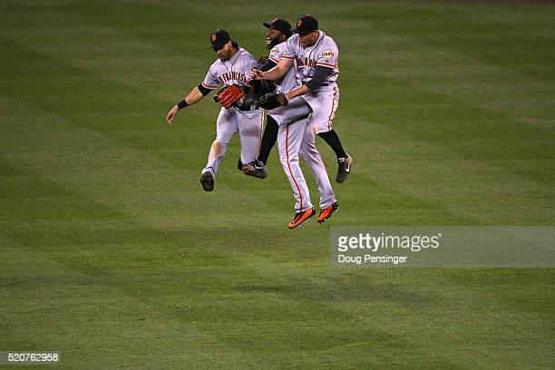 Angel Pagan, Denard Span and Hunter Pence of the San Francisco Giants celebrate their 7-2 victory over the Colorado Rockies at Coors Field on April...