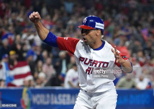 Angel Pagan of Puerto Rico celebrates after scoring during the first inning of the World Baseball Classic Pool F Game Four between the United States...
