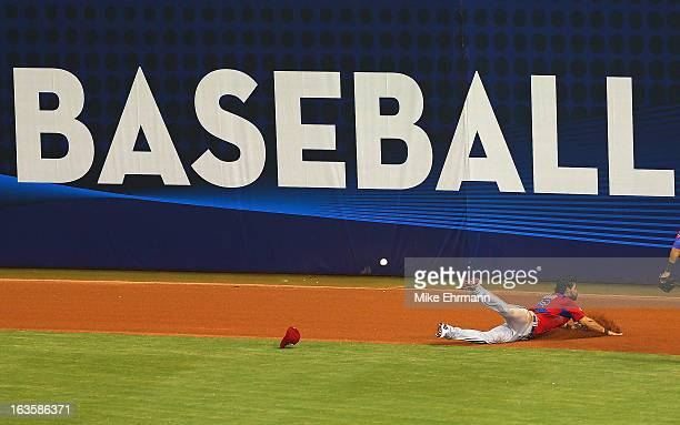 Angel Pagan of Puerto Rico misses a fly ball with the bases loaded during a World Baseball Classic second round game against the United States at...