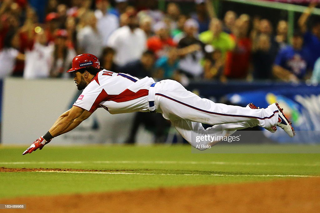 Angel Pagan of Puerto Rico slides into third base with a triple as Miguel Tejada waits of the Dominican Republic waits for the ball during the first round of the World Baseball Classic at Hiram Bithorn Stadium on March 10, 2013 in San Juan, Puerto Rico.