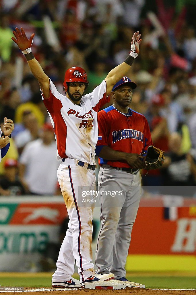 Angel Pagan of Puerto Rico stands with a triple as Miguel Tejada of the Dominican Republic looks on during the first round of the World Baseball Classic at Hiram Bithorn Stadium on March 10, 2013 in San Juan, Puerto Rico.