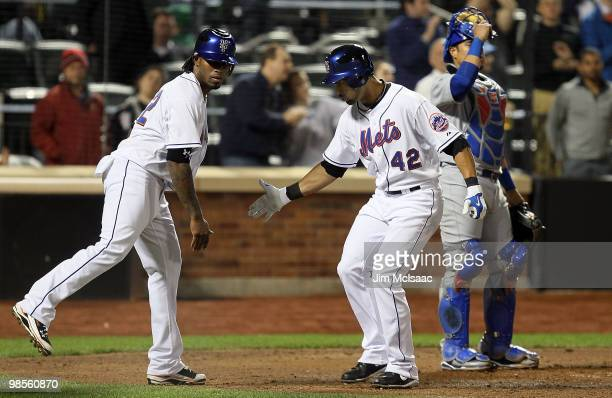 Angel Pagan of the New York Mets celebrates his seventh inning two run home run against the Chicago Cubs with teammate Jose Reyes on April 19 2010 at...