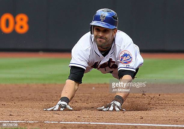 Angel Pagan of the New York Mets dives into third base for a second inning tworun triple against the Los Angeles Dodgers on April 28 2010 at Citi...
