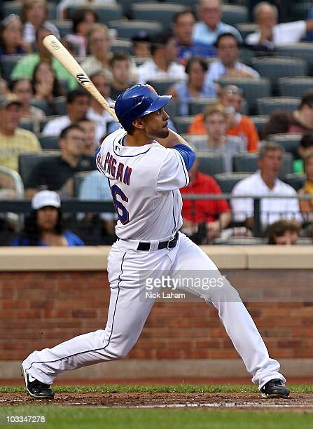 Angel Pagan of the New York Mets hits a two run home run in the first inning against the Colorado Rockies at Citi Field on August 11 2010 in the...