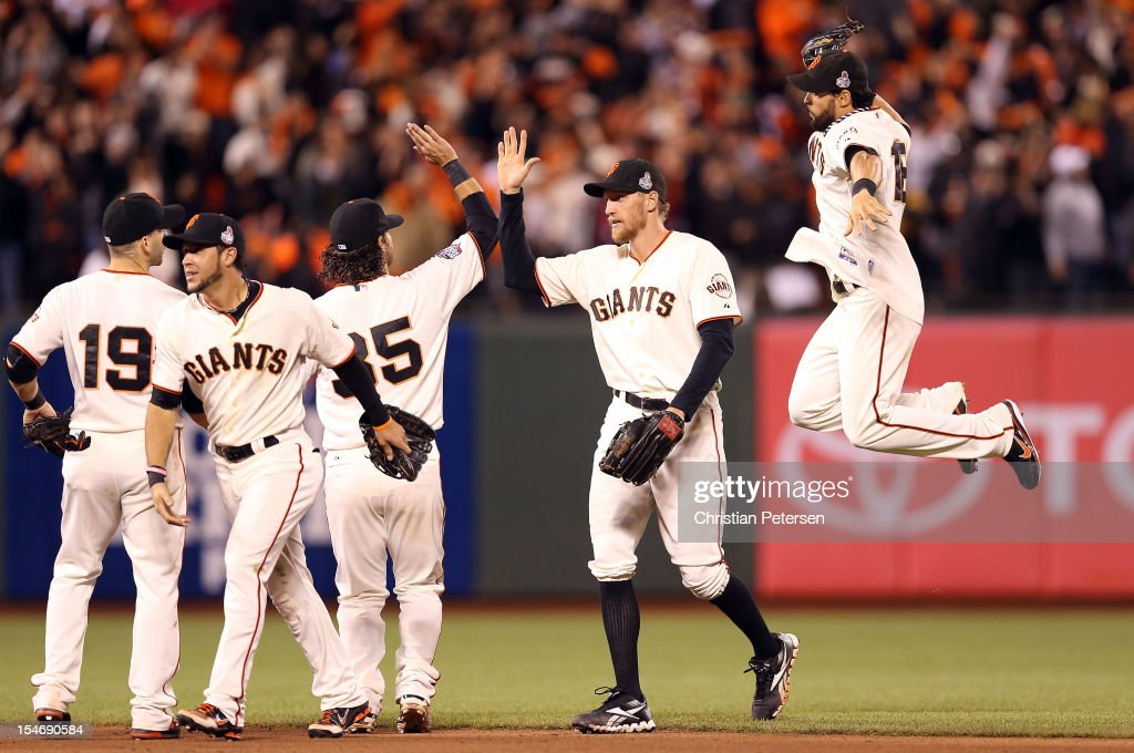 Angel Pagan #16 of the San Francisco Giants an celebrates with his teammates after defeating the Detroit Tigers in Game One of the Major League Baseball World Series at AT&T Park on October 24, 2012 in San Francisco, California. The Giants defeated the Tigers 8-3.