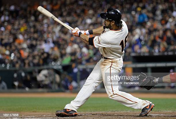 Angel Pagan of the San Francisco Giants breaks his bat hitting a base loaded tworun single against the Washington Nationals in the seventh inning at...