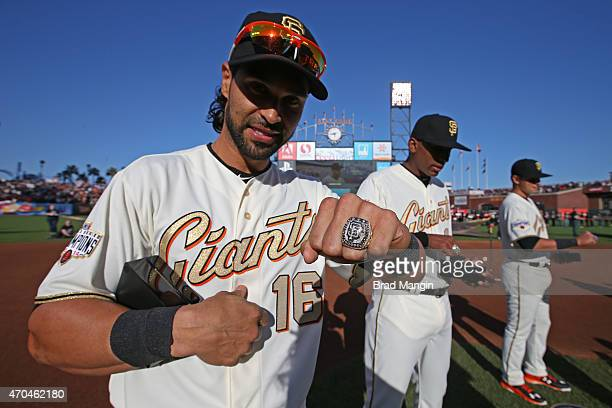 Angel Pagan of the San Francisco Giants displays his World Series ring during the San Francisco Giants 2014 World Series Ring ceremony before the...