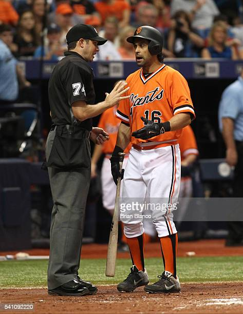 Angel Pagan of the San Francisco Giants has a discussion with home plate umpire John Tumpane after striking out looking to end the top of the fourth...
