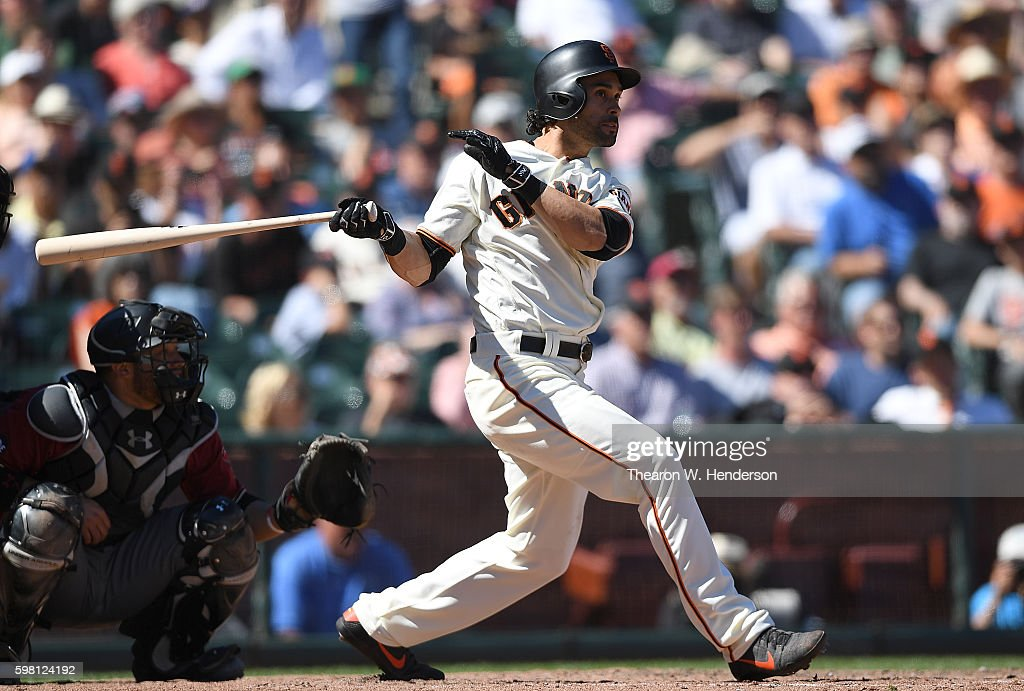 Angel Pagan #16 of the San Francisco Giants hits an RBI double scoring Conor Gillaspie #21 against the Arizona Diamondbacks in the bottom of the seventh inning at AT&T Park on August 31, 2016 in San Francisco, California.
