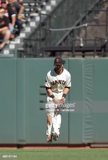 Angel Pagan of the San Francisco Giants jumps in the air to keep the ball in front of him on a base hit to centerfield by David Peralta of the...