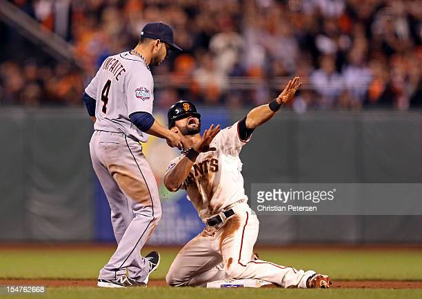 Angel Pagan of the San Francisco Giants reacts after he successfully stole second base against Omar Infante of the Detroit Tigers in the eighth...