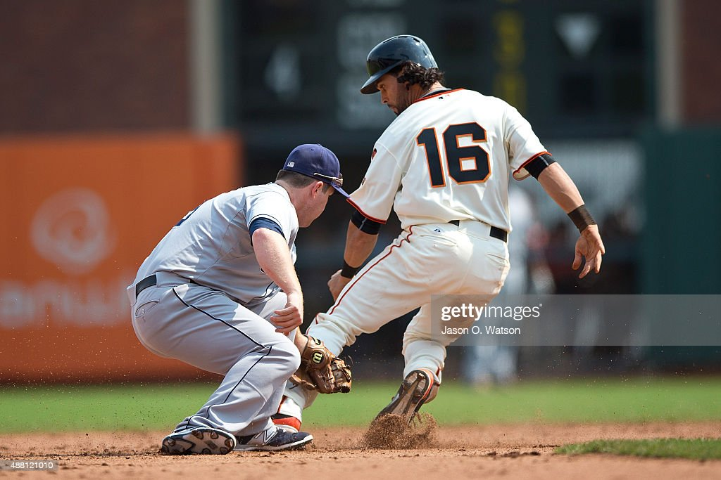 Angel Pagan #16 of the San Francisco Giants steals second base ahead of a tag from Jedd Gyorko #9 of the San Diego Padres during the fifth inning at AT&T Park on September 13, 2015 in San Francisco, California. The San Francisco Giants defeated the San Diego Padres 10-3.