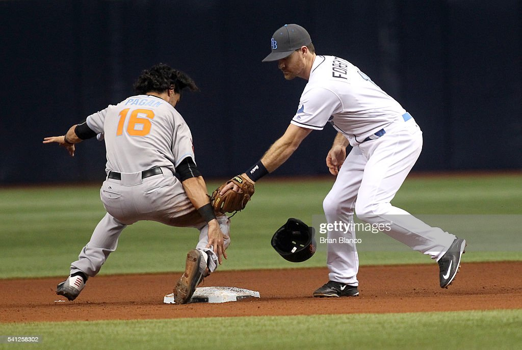 Angel Pagan #16 of the San Francisco Giants steals second base in front of second baseman Logan Forsythe #11 of the Tampa Bay Rays during the fifth inning of a game on June 19, 2016 at Tropicana Field in St. Petersburg, Florida.