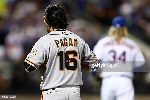 Angel Pagan of the San Francisco Giants wears a jersey with JF written on his number in memory of Jose Fernandez during their National League Wild...