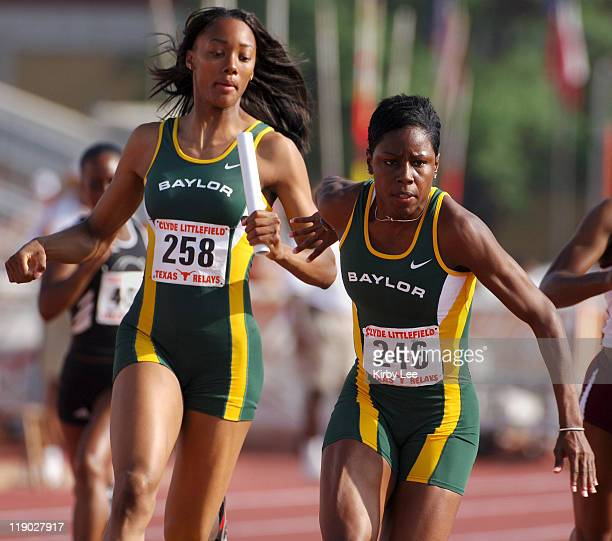 Angel Perkins takes handoff from Kandace Tucker on the third leg of Baylor women's 4 x 100meter relay that timed 4460 to place third in its heat in...