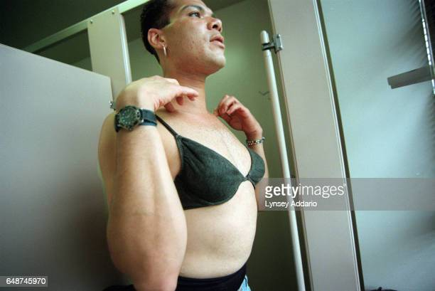 Angel puts on her bra in a public bathroom at the Gay Men's Health Crisis Center in the meatpacking district of New York City in Sept 1999 Angel's...