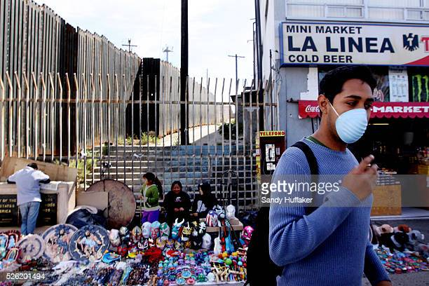 Angel Ramirez wears a surgical mask while at the MexicoUnited States border crossing on Sunday May 3 2009 The H1N1 Swine Flu warning has hobbled...