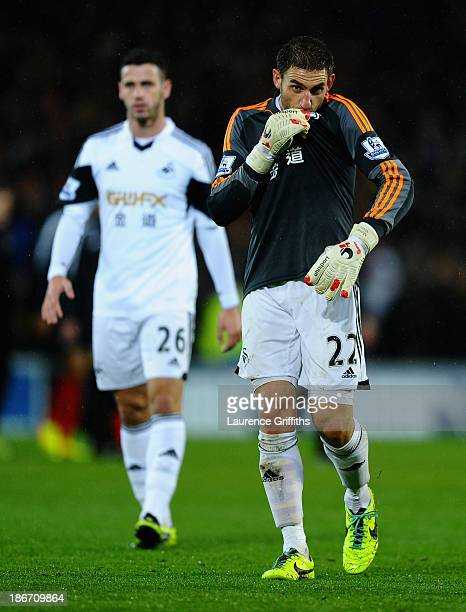 Angel Rangel and Alvaro Vazquez of Swansea show their dissapointment after defeat in the Barclays Premier League match between Cardiff City and...