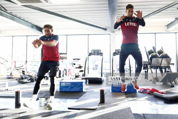 Angel Rangel and Federico Fernandez exercise in the gym during the Swansea City Training at The Fairwood Training Ground on December 15 2017 in...