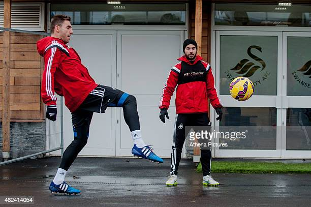 Angel Rangel and Jordi Amat of Swansea City play around with the ball outside the training ground on January 28 2015 in Swansea Wales