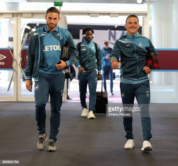 Angel Rangel and Roque Mesa of Swansea City arrive prior to the Premier League match between West Ham United and Swansea City at the London Stadium...