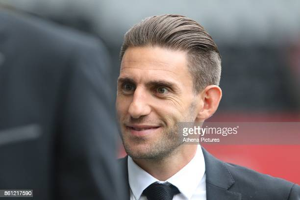 Angel Rangel of Swansea City arrives at Liberty Stadium prior to kick off of the Premier League match between Swansea City and Huddersfield Town at...
